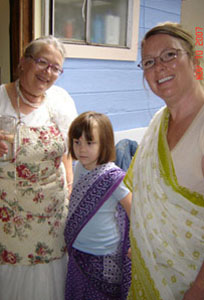 The backbone of the Soquel kitchen, Srimati Sureshvari Didi with her grandaughter Sage and daughter, Adisvara.