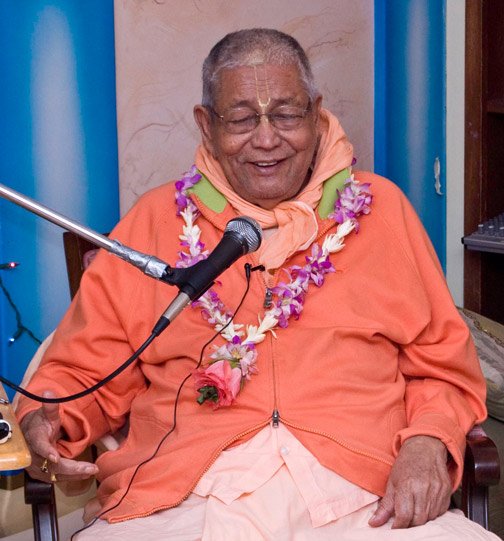 Then Srila Gurudev happily comes to the temple and speaks to all of the devotees and sings two songs.