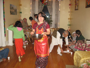 The Prasadam Feast. Nalina Sundari, a new resident of the Ladies Seva Ashram, helps to serve out prasadam.