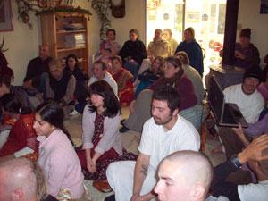 The devotees happily listen.