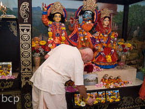 Their ever vigilant servitor Sripad Ramai Prabhu offers flowers during Arotik.
