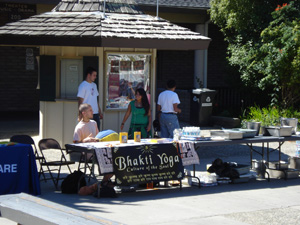 Our tables were set up outside in the middle of the Aptos campus quad. Dhruva Prabhu and Chitra  Devi Dasi, both students, came to help serve happily.