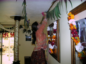 Meanwhile in the Temple room, Krishna Madhuri, Nalina Sundari and Diksavati Didis begin to design and hang the garlands.