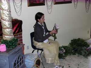 Mahadevi helps with the flower decorations.
