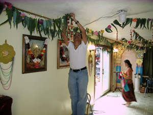 Adi Kesava Prabhu assists in hanging the garlands too.