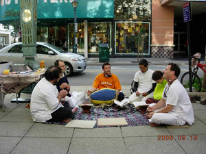 The enthusiasm grew and the seated bhajan became dancing kirtan. Passersby joined in.