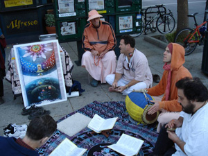 The kirtan party then moved to a new position downtown and there Kalindi Didi in record time gives out a very large stack of invitations.