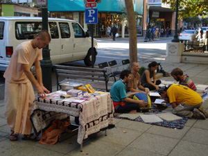 As Kamal Krishna Prabhu set up the book table downtown Santa Cruz, the Harinam Sankirtan began with Nowla Kishore and Giridhari Prabhus along with Mahadevi Didi and some curious people joined the kirtan.