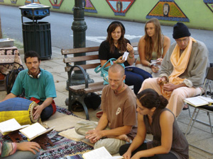 After two young girls were talking with Kamal Krsna,they sat down for a while to listen the kirtan.
