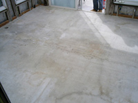 The old floor in Tulsi Devi's house as it is prepared for remodeling.
