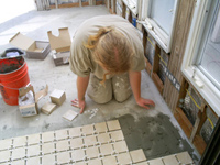 Ramachandra Prabhu working with talented craftsmanship to lay out the new floor.