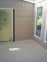 The newly finished ceramic tile walls and floor for Srimati Tulsi Devi