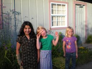 The children played in the sun. Here are Kumaris Radha Dasi, Syama Mohini and Anjali.
