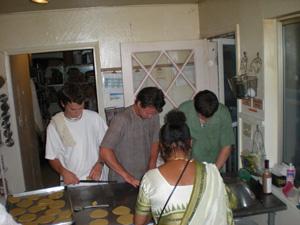 Ramananda and Shatrughna Prabhus, Divyashakti Didi and Gaur Nataraj Prabhu roll puris.