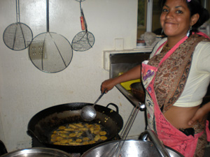 Vrinda Didi fries the okra pakoras.