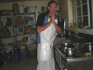 Jaya Gauranga Prabhu respectfully attends to Their Lordships cooking paraphernalia.