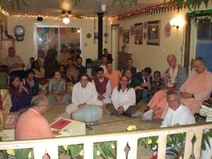In the Temple room Sripad Janardan Maharaj leads a beautiful program.