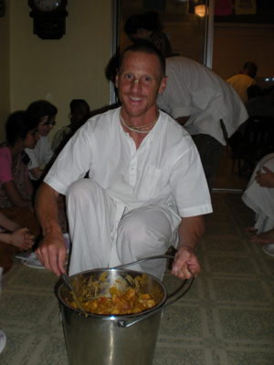 Giridhari Prabhu serves another sabji.