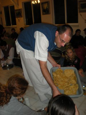 Giridhari Prabhu, our webmaster, serves the puris.