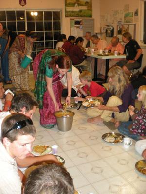 Satyabhama Devi Dasi serves the dahl