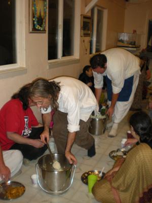 Dinatiharo Prabhu serves the rice followed by Vidura Krishna Prabhu with the dahi vada.