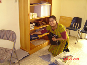 In the Temple room Kalindi Didi took on the bookshelf for the songbooks,