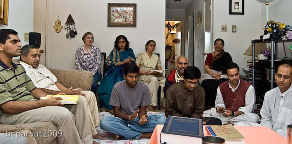 Devotees and friends gathered in the home of Jairam Prabhu.