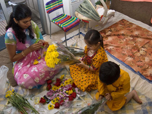 Monica, Lavanika and and Nabh string garlands for the festival.