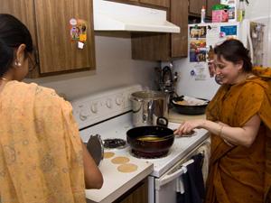 Abha Devi Dasi happily fries puris.