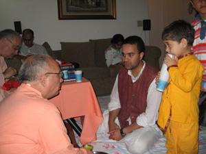 Even during Prasadam the discussions continue.