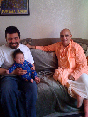 Devotees and friends gathered in the home of Harindhu Prabhu and Rasa Rajani Devi Dasi.