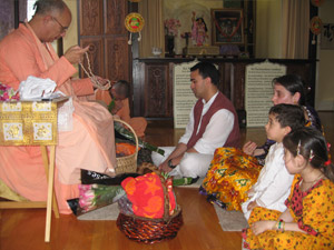 Jairam Prabhu surrounded by his family receives Srila Gurudev's divine connection via Sripad Janardan Maharaj.