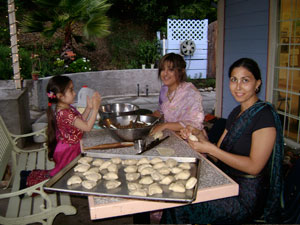 Young Lavanica helps Dhanistha and Sara roll samosas for the feast. Sara also helped to sew the beadwork on Sriman Giridhari's beautiful yellow dhoti.