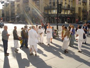 As the devotees arrived downtown the sun brought out its glow and seemed to focus on the kirtan group.