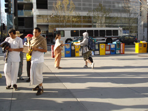 The kirtan party stopped for a long time in front of the new San Jose Public Library. This facility is used by the local University and families alike.