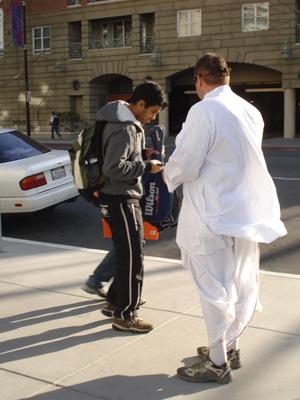 Vidura Krishna Prabhu offers an invitation to a student.