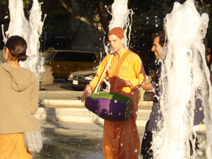 The Harinam party playfully danced back and forth through the fountain.
