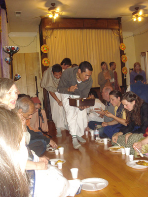 and serving Mahaprabhu's Prasadam to the devotees.