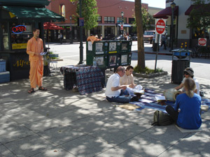Our book table and kirttan set up downtown Santa Cruz on Pacific Ave.