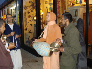 And once again back downtown as the lights come one the kirtan continues.