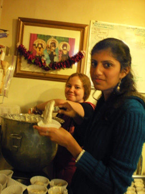Kumaris Rohini and Devaki help with the cupcakes.