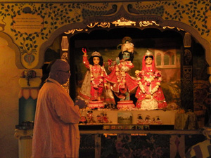Srila Janardan Maharaj in front of Their Lordhships.